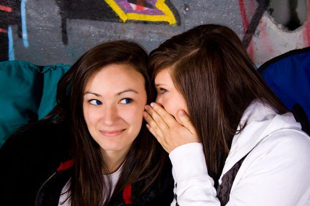 Teenagers Whispering a Secret