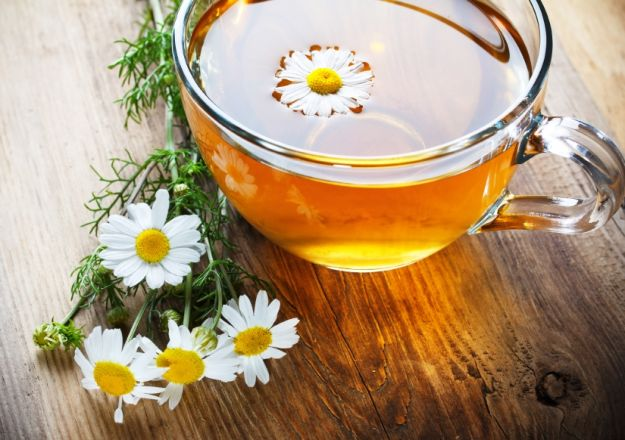 chamomile tea on wooden table