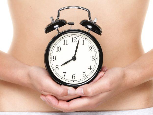 Biological clock ticking woman holding watch